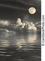 Golden Full Moon - Stormy night sky with cumulus clouds and...