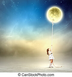 Little girl pulling moon - Image of little girl in white...