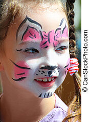 cute little girl with cat makeup painted face