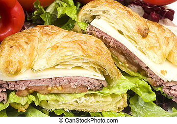 gourment roast beef sandwich on croissant