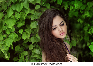 Beautiful Woman with Curly Long Hair. Outdoors Portrait on...