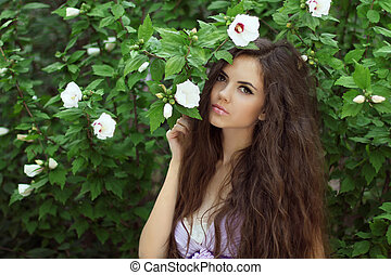 Beautiful Woman with Curly Long Hair Outdoors Portrait on...