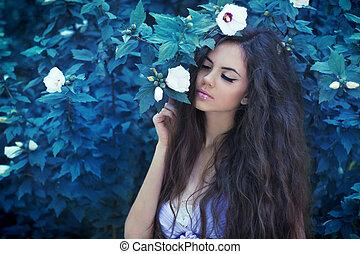 Fairytale portrait of Beautiful brunette girl enjoying the freshness