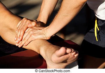 sports massage - Therapist giving a leg massage