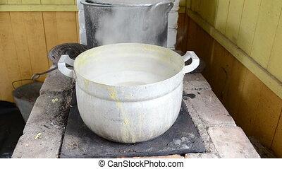 peas boil steel pot - peas boil in steel pot on old retro...