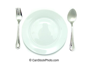 place setting - Knife and fork silverware with white plate...