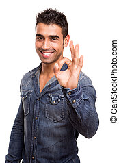Portrait of a young man showing Ok sign