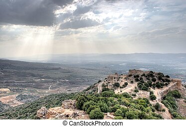 Israeli landscape with castle and sky - Castle ruins in...