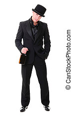 Retro stylish man in black suit with bottle of drink