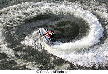 Jet Ski Action - Jet ski team formed a circle in the water...