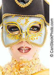 Gold face make-up - Young woman face with gold make-up and...