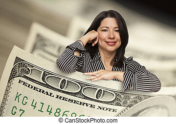 Hispanic Woman Leaning on a One Hundred Dollar Bill -...