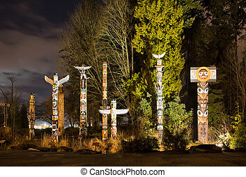 Totems in Stanley Park Vancouver at night - The Totems in...