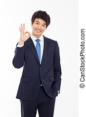 Young Asian business man showing okay sign. - Young Asian...