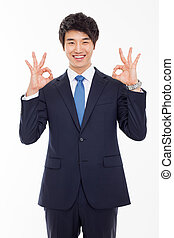 Young Asian business man showing okay sign - Young Asian...