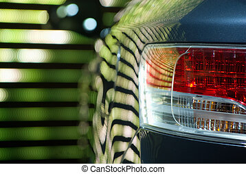 Rear Car Light against a neon multicolored backgroung