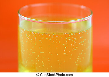 Calcium effervescent tablet - A glass of orange flavored...
