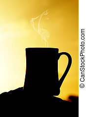 Silhouettes on sunrise coffee at the beach in the morning.