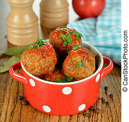 meatballs in a red pot