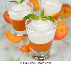 Apricot dessert in small glasses on a white table