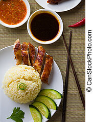 hainan chicken rice , singapore food with materials as background
