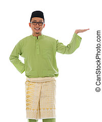Traditonal Malay man with welcome gesture during ramadan...