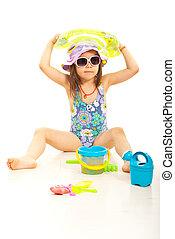 Cute beach girl with toys