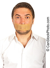 Man with duct tape over mouth - Portrait of man with duct...