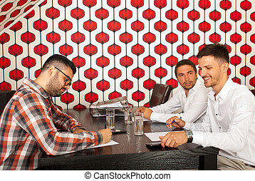 Business men having conversation at meeting in a modern room