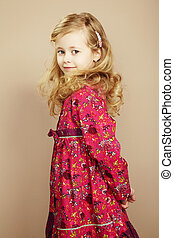 Portrait of pretty little girl. Fashion photo
