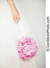 Wedding bouquet in hands of bride