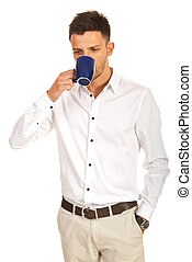 Casual business man drinking coffee isolated on white...