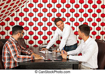 Men having happy discussion at meeting - Three men having...