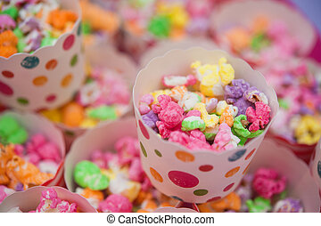 Coloured popcorn - Small Cups of coloured popcorn at a party