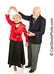 Senior Dancing - Twirl - Senior man twirls his wife as they...