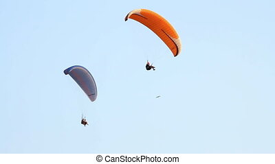 Paragliding over the mountains against clear blue sky
