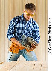 worker adjusting detail sander
