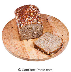 loaf of multigrain bread and sliced piece on wooden board...