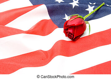 Memorial - A red rose on an American flag.