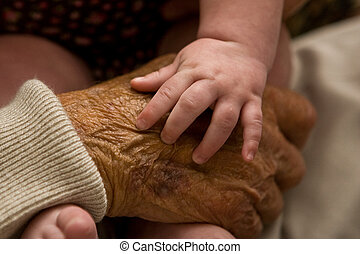 Grandpa\\\'s hand - Infant \\\'s hand resting on her...