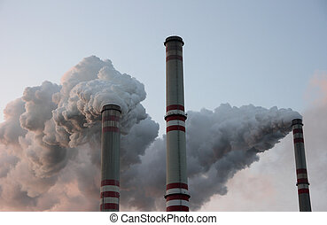 Coal power plant chimneys - Three smoking chimneys in coal...