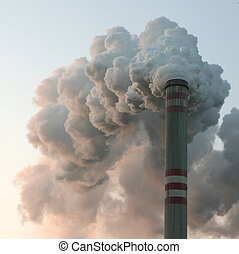 Thin chimney in coal power plant with huge dark smoke stack