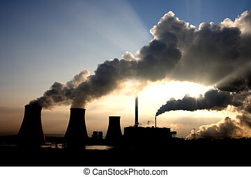 Coal power plant fumes - View of coal powerplant against sun...