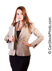 Beautiful businesswoman with a laptop in hand isolated on white background studio shot