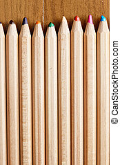 Row of blunt pencils over wooden surface