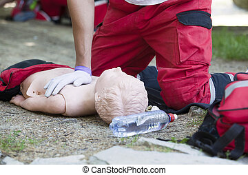 CPR training - Demonstrating CPR on a dummy