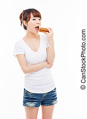 Young Asian woman eat sandwhich - Young Asian woman eat...