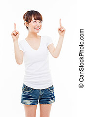 Smiling young woman pointing upwards isolated on white...