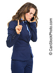 Busy business woman talking cell phone