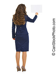 Full length portrait of business woman showing blank paper...